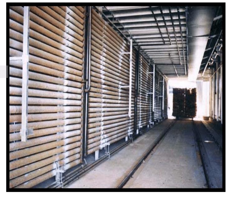 گرمای داخل لوله های داغ از طریق هوا به چوب می رسد.